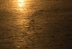 Golden sunlit background. Golden sunlit mosaic or cobblestones background Stock Photos