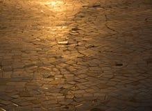 Golden sunlit background. Golden sunlit mosaic or cobblestones background Royalty Free Stock Image