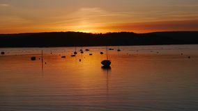 Sunset across The River Exe Estuary in Exmouth Uk. Golden sunrays of a sunset across the water in Exmouth a popular holiday town in Devon South West England stock image