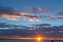 Golden sunrise with clouds and blue skies. Golden sunrise, clear blue skies Stock Photography