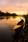 Golden sunrise on Don Det. Beautiful golden sunrise on Don Det in south Laos. Landscape of nature taken on four thousands islands Si Phan Don on Mekhong river in stock images