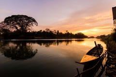 Golden sunrise on Don Det. Beautiful golden sunrise on Don Det in south Laos. Landscape of nature taken on four thousands islands Si Phan Don on Mekhong river in stock photography