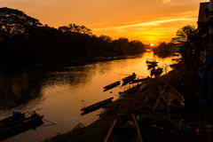 Golden sunrise on Don Det. Beautiful golden sunrise on Don Det in south Laos. Landscape of nature taken on four thousands islands Si Phan Don on Mekhong river in royalty free stock photography