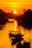 Golden sunrise on Don Det. Beautiful golden sunrise on Don Det in south Laos. Landscape of nature taken on four thousands islands Si Phan Don on Mekhong river in royalty free stock image