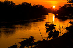 Golden sunrise on Don Det. Beautiful golden sunrise on Don Det in south Laos. Landscape of nature taken on four thousands islands Si Phan Don on Mekhong river in stock photos