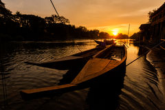 Golden sunrise on Don Det. Beautiful golden sunrise on Don Det in south Laos. Landscape of nature taken on four thousands islands Si Phan Don on Mekhong river in royalty free stock photo
