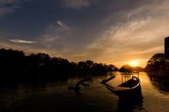 Golden sunrise on Don Det. Beautiful golden sunrise on Don Det in south Laos. Landscape of nature taken on four thousands islands Si Phan Don on Mekhong river in royalty free stock images