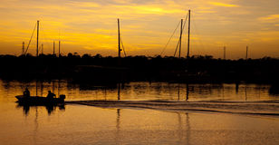 Golden Sunrise Fishing Boat. Sunrise down at the Townsville Marina QLD Australia with fishermen heading out Royalty Free Stock Image