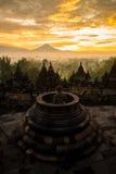 Golden sunrise over Borobudur stupa Stock Photos