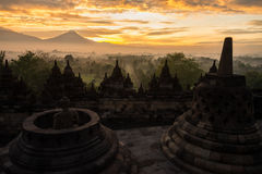 Golden sunrise over Borobudur stupa Royalty Free Stock Images