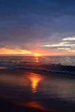 Golden Sunrise Over the Ocean. Golden and glowing ocean sunrise Royalty Free Stock Photography