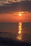 Golden Sunrise Over Ocean. The sunrises over the ocean early in the morning Stock Photos