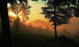 Golden Sunrise Over Pilot Mountain Royalty Free Stock Photography