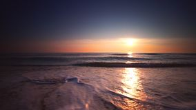 Sunrise over the sea and beach. Waves washing the sand. stock video footage