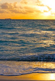 Golden sunrise over the stormy ocean. Royalty Free Stock Photo