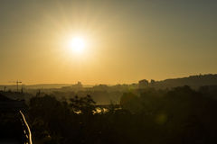 Golden sunrise in Prague taken from the Letna park, with cityscape and the Vltava river on the horizon Royalty Free Stock Image