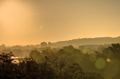 Golden sunrise in Prague taken from the Letna park, with cityscape and the Vltava river on the horizon Stock Image