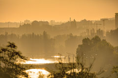 Golden sunrise in Prague taken from the Letna park, with cityscape and the Vltava river on the horizon Stock Photo