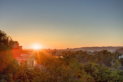 Golden sunrise in Prague taken from the Letna park, with cityscape and the Vltava river on the horizon Royalty Free Stock Images