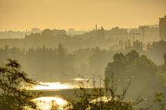 Golden sunrise in Prague taken from the Letna park, with cityscape and the Vltava river on the horizon Royalty Free Stock Photo