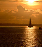 Golden Sunrise, with silhouetted sailboat. In reflection. Taken in Sebastian, Florida Royalty Free Stock Photos