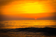 Golden sunrise sunset over the sea ocean waves Royalty Free Stock Photography