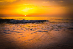 Golden sunrise sunset over the sea ocean waves Royalty Free Stock Photos