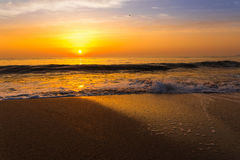 Golden sunrise sunset over the sea ocean waves Stock Image