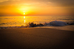 Golden sunrise sunset over the sea ocean waves Stock Photos