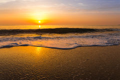 Golden sunrise sunset over the sea ocean waves Stock Images