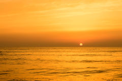 Golden sunrise sunset over the sea ocean waves Stock Photography