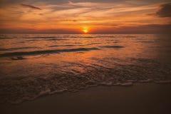 Golden sunrise sunset over the sea ocean waves.  Royalty Free Stock Photo