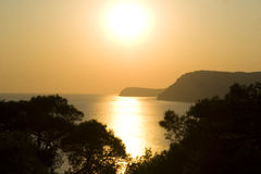 Gold sea. The golden sunset  above sea ad mounties Royalty Free Stock Photo