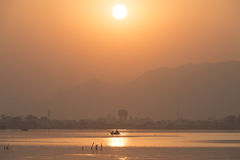 Golden sunset at Ana Sagar lake in Ajmer, India with silhouettes. Of trees and fisherman royalty free stock photography
