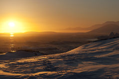 Golden sunset in Antarctica. Set in Antarctica, on the background of the ocean Stock Photos