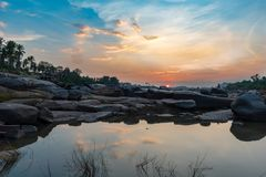 Golden Sunset on the banks of the Tungabhadra river in Hampi Ind. A colorful Golden Sunset on the banks of the Tungabhadra river in Hampi India royalty free stock photos