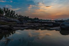 Golden Sunset on the banks of the Tungabhadra river in Hampi Ind. A colorful Golden Sunset on the banks of the Tungabhadra river in Hampi India stock image