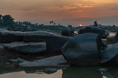 Golden Sunset on the banks of the Tungabhadra river in Hampi Ind. A colorful Golden Sunset on the banks of the Tungabhadra river in Hampi India stock images