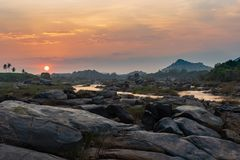 Golden Sunset on the banks of the Tungabhadra river in Hampi Ind. A colorful Golden Sunset on the banks of the Tungabhadra river in Hampi India royalty free stock image