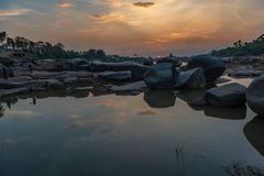 Golden Sunset on the banks of the Tungabhadra river in Hampi Ind. A colorful Golden Sunset on the banks of the Tungabhadra river in Hampi India stock photography