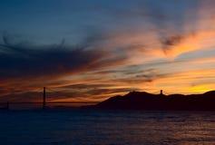 Golden sunset. Sunset behind the Golden Gate Bridge in San Francisco, California Royalty Free Stock Image