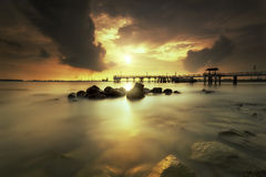 Golden Sunset. The cloudy sunset creating a nice drama Stock Images