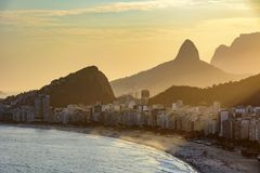 Golden sunset between Copacabana buildings Royalty Free Stock Image
