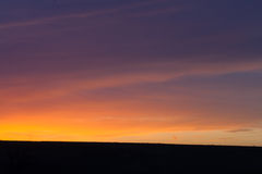 Golden Sunset and Dark Blue Sky. The sky turns to a deep blue as the golden sunset fades Royalty Free Stock Photography