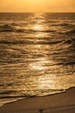 A Golden Sunset. A dramatic sunset over the sea in Barbados Stock Photography