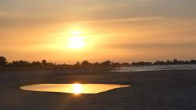 A golden sunset at Dzharylhach island in summer in slo-mo