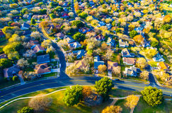 Golden Sunset Fall Colors over Home Community Suburbia Neighborhood. Real Estate Back of Community with Colorful Leaves turning colors for Fall Autumn Texas Hill royalty free stock photography