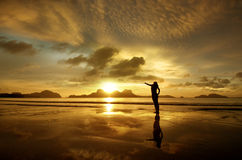 Golden sunset with girl on the island of El Nido,Philippines. Golden sunset with the girl on the island of El Nido, Philippines royalty free stock photo