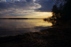 Golden sunset on the lake.  Royalty Free Stock Images