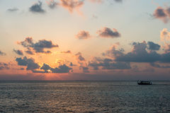 Golden sunset in maldives with donhi Stock Photo